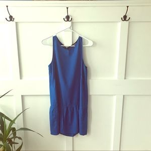 Sleeveless dress with babydoll bottom
